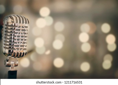 Close-up of retro microphone with blur bokeh background and copy space for text.