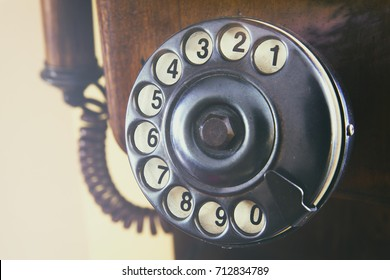 Close-up retro phone dial-plate. Horizontal indoors shot.