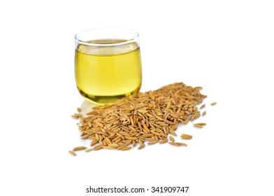 closeup rice bran with bran oil in glass on white background
