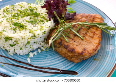 Closeup of rice with steak on the plate
