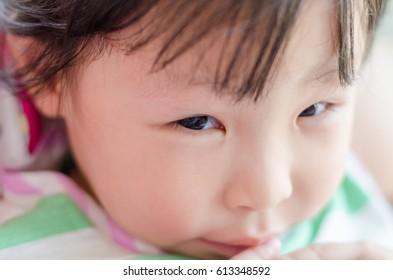 Closeup right eye of little asian girl