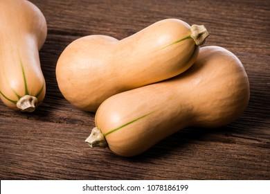 closeup ripe butternut squash on wooden desk