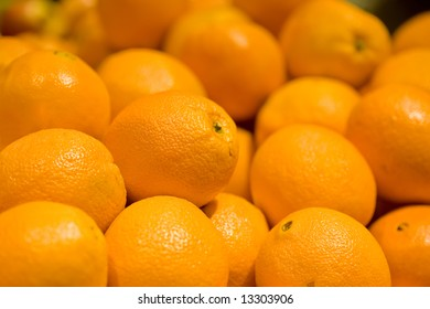A close-up of ripe organic navel oranges