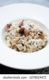 Close-up risotto with chanterelle mushrooms and grated parmesan, selective focus