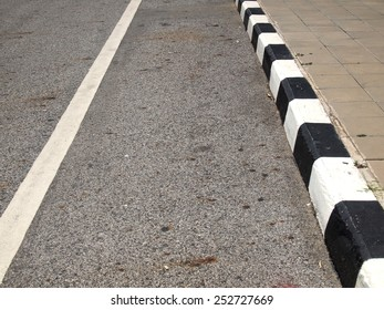closeup of road with black and white line