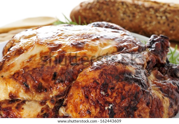 closeup of a roast turkey, served on a table