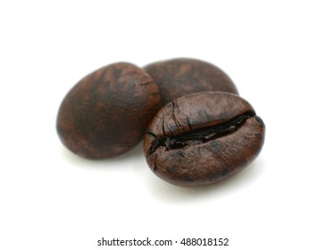 Closeup of roasted coffee beans isolated on white background