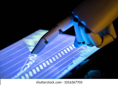 Close-up Of A Robot's Hand Using Digital Tablet With Financial Graphs On Screen