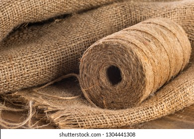 Close-up roll of hemp rope on sackcloth