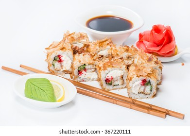 closeup roll sushi with chopsticks and wasabi (shallow DOF)