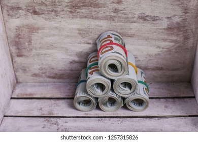 Close-up rolled American dollars banknotes