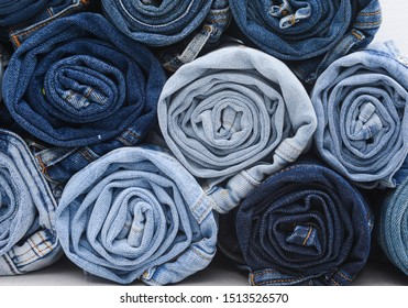 Closeup rolled of blue jeans pants, dark blue denim trousers showing texture isolated