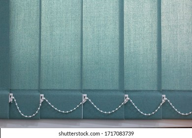 Close-up of roller blinds or curtain at the glass window