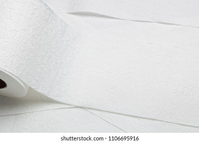 Closeup of rolls of overlapping toilet paper
