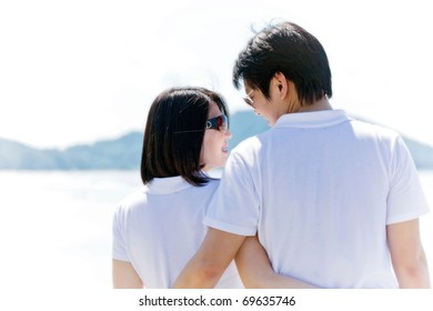 closeup of romantic couples, each other seeing eyes on the beach