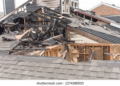 Close-up the roof of damaged apartment after burned by fire in Texas, America. Smoke and dust in burn scene of arson investigation course. Insurance theme of fire devastated