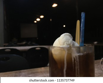 Closeup of root beer with a scoop of vanilla ice cream on the table