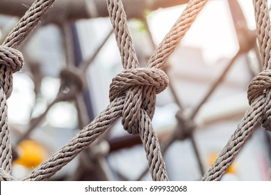 Close-up of rope knot line tied together with playground background.selective focus.