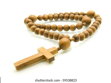 Close-up of Rosary beads isolated over white