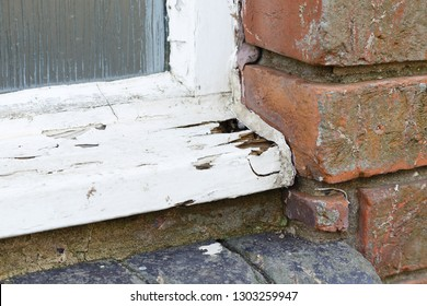 Closeup of a rotten old wooden window frame