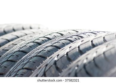 Closeup of row of new car tires