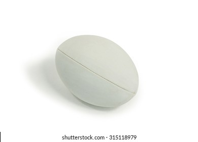 Close-up of rugby ball over white background