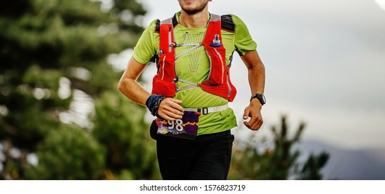 closeup runner athlete with camelbak run ultra marathon