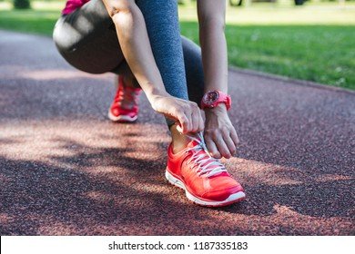 Closeup of runner tying shoelaces before running