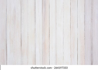Closeup of a rustic whitewashed wood background. The boards are straight up and down.