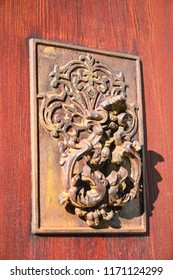 close-up of Rusty Antique door knocker on wooden door