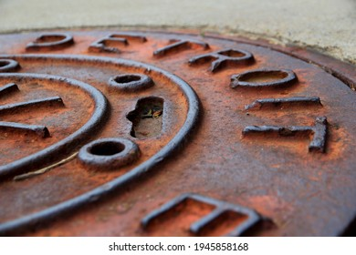 Close-up of Rusty Detroit Manhole Cover