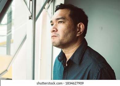 Closeup sad young man with worried stressed face expression looking out window and brain melting into lines question marks. Obsessive compulsive, adhd, anxiety disorders