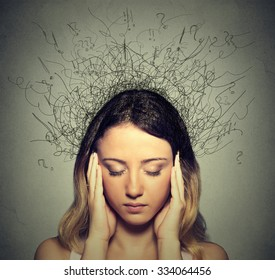 Closeup sad young woman with worried stressed face expression and brain melting into lines question marks. Obsessive compulsive, adhd, anxiety disorders