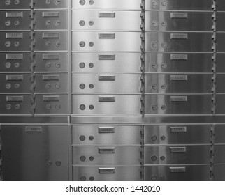 closeup of safety deposit boxes in bank