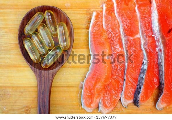 Close-up of salmon oil capsules