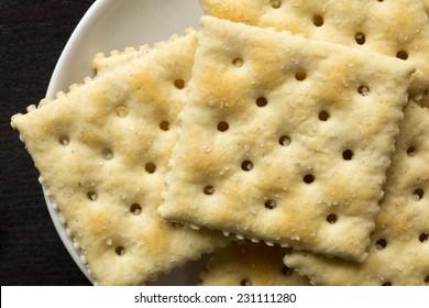 Closeup of saltine crackers.