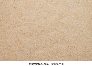 closeup of sand background pattern of a beach in the summer
