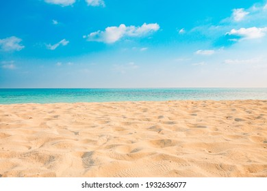 Closeup of sand on beach and blue summer sky. Panoramic beach landscape. Empty tropical beach and seascape. Orange and golden sunset sky, soft sand, calmness, tranquil relaxing sunlight, summer mood  - Shutterstock ID 1932636077