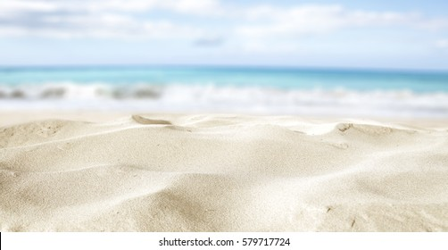 closeup of sand on beach and blue summer sky