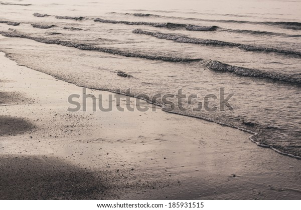 Closeup of sand and wave,evening sand and wave