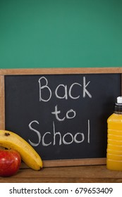 Close-up of sate with text back to school and breakfast on table