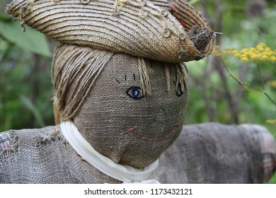 Close-up of scarecrow with hat in garden