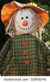 Closeup of a scarecrow with sunlight in the garden