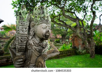 Closeup of a scary statue of a guardian in a traditional garden, Bali, Indonesia