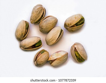 Closeup of Scattered Random Pistachio Nuts on a white background