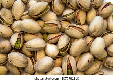 Closeup of Scattered Random Pistachio Nuts forming a  background