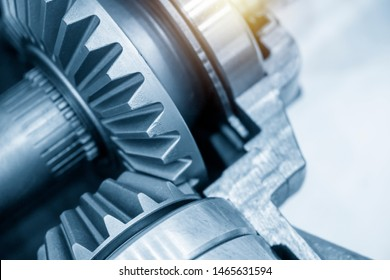 Close-up scene of the differential gear of automotive transmission system.The abstract scene of the drive and pinion gear parts.