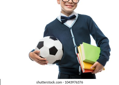 close-up of schoolboy's hand with ball and textbooks, schoolboy isolated