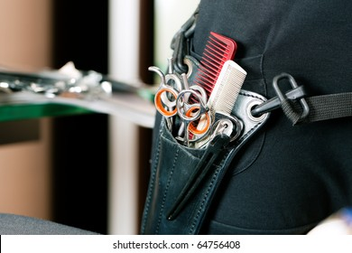 Closeup of Scissor bag or holster of hairdresser worn around the hip with lots of tools