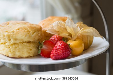 Close-up of Scones with fresh strawberry, Afternoon tea set on wooden table
